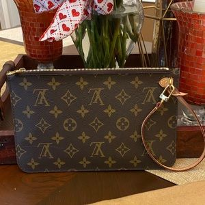 Authentic Louis Vuitton Neverfull wristlet monogra